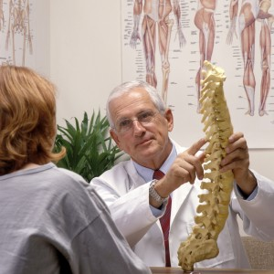 chiropractor explaining spine health